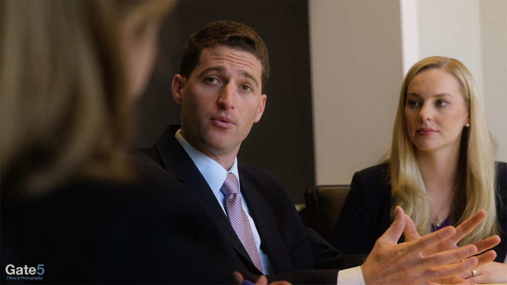 a man and woman in a business meeting in a a corporate video