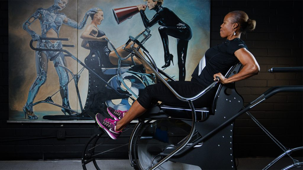 a woman uses a HIIT exercise machine
