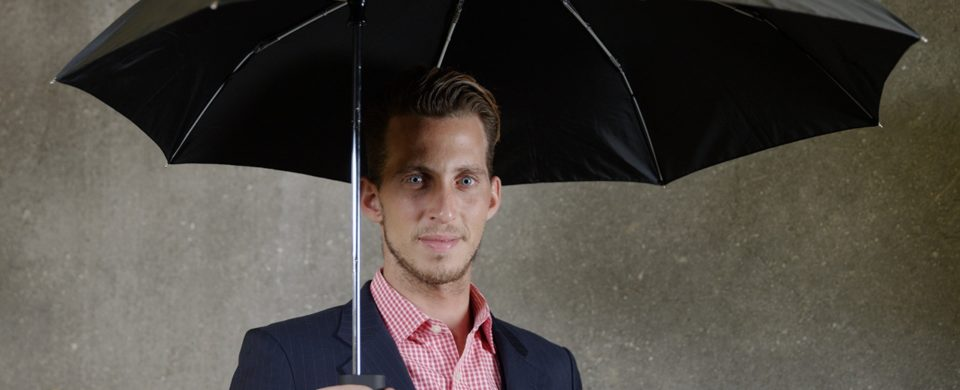man with a travel umbrella in ecommerce product video