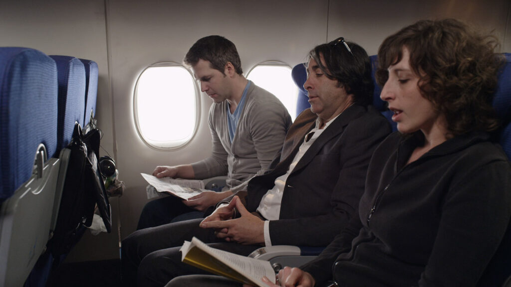 airplane passengers in a travel product drtv video for a case
